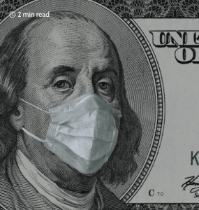 Benjamin Franklin portrait close-up on 100 dollars banknote in a medical mask. Close up.